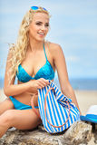 Summer holidays, vacation and beach concept. Girl in bikini and shades on the beach Royalty Free Stock Images