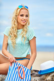 Summer holidays, vacation and beach concept. Girl in bikini and shades on the beach Stock Images