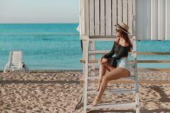 Summer holidays and vacation concept - girl in bikini standing on the beach.  stock photography