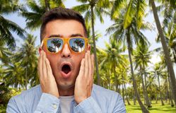Surprised man in sunglasses over tropical beach royalty free stock photos