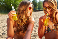 Summer holidays and vacation, girls in bikinis Stock Photos