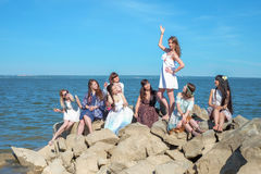Summer holidays and vacation - girls with drinks near the sea royalty free stock photography