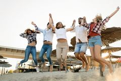 Summer, holidays, vacation and happiness concept. Group of friends Stock Photos