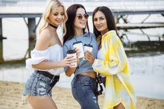 Summer, holidays, vacation, happy people concept - beautiful teenage girls or young women having fun on the beach. Royalty Free Stock Image