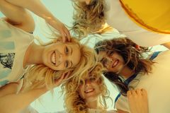 Summer, holidays, vacation, happy people concept - group of teen. Agers looking down royalty free stock photo