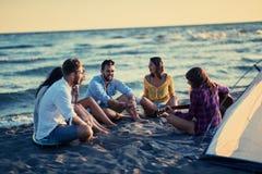 Summer, holidays, vacation, music, happy people concept - group. Summer, holidays, vacation, music, happy people concept –group of smiling young friends stock image