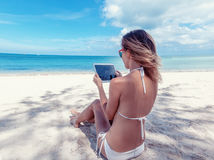Summer holidays, vacation, technology and internet - girl lookin Royalty Free Stock Image