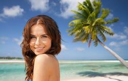 Happy woman in bikini swimsuit on tropical beach Royalty Free Stock Photo