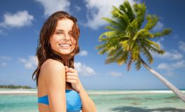 Happy woman in bikini swimsuit on tropical beach Royalty Free Stock Photography