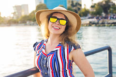 Summer holidays, vacation, travel and people concept - smiling young woman wearing sunglasses and hat on beach over sea. Summer holidays, vacation, travel and Royalty Free Stock Images