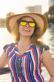 Summer holidays, vacation, travel and people concept - smiling young woman wearing sunglasses and hat on beach over sea. Summer holidays, vacation, travel and Royalty Free Stock Photography