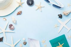 Summer holidays, vacation, travel and tourism frame from sunglasses, hat, passport, airplane and boat miniatures, starfish. Top view. Flat lay stock photography