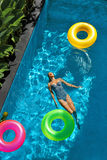 Summer Holidays. Woman Enjoying Vacation, Floating In Swimming Pool Stock Photos