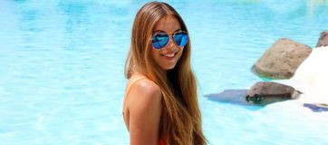 Summer holidays woman relaxed in Tenerife tropical swimming pool banner panorama.  royalty free stock images