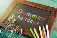 Summer holidays - written with crayons on the chalkboard. Text Summer holidays written with crayons on the chalkboard stock images