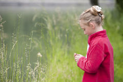 Summer holidays: young girl outdoors in nature Stock Photo