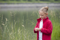 Summer holidays: young girl outdoors in nature Royalty Free Stock Photo