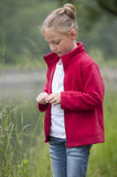 Summer holidays: young girl outdoors in nature Stock Photos