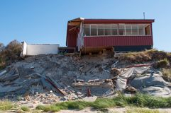 Summer home falling into the beach in northern Jutland. In Denmark Royalty Free Stock Photo