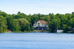 Summer home on a lake Stock Images
