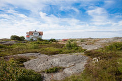 Summer home in the swedish archipelago. The nature is typical, rocky and somewhat cold, for the swedish west coast stock photos