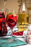Summer home wine with fruits, sangria cocktail, dogwood berries plate Stock Photo