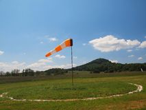 Summer hot day on sport airport with Abandoned windsoc, wind Royalty Free Stock Images