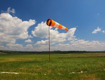 Summer hot day on sport airport with Abandoned windsoc, wind Stock Images
