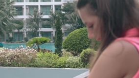 Summer hotel resort with blurred tanned lady on foreground stock video footage