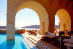 Summer hotel terrace with sea view and outdoor pool, Crete, Gree Stock Photos