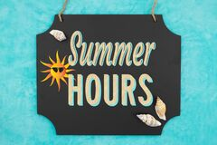 Free Summer Hours Hanging Chalkboard Sign With Seashells Stock Photos - 187685343