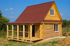 Summer House. Small wooden house built in the field for summer vacation Royalty Free Stock Images