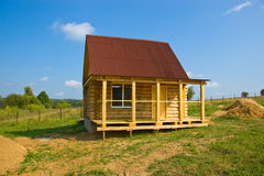 Summer house_2. Small wooden house built in the field for summer vacation Stock Image