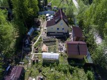 Summer house, barns, sauna, greenhouses in garden on small land of country, Russia Royalty Free Stock Photography