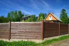 Summer house behind a fence Royalty Free Stock Photo