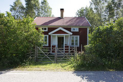 Summer house. A cozy red house in the country side Stock Image