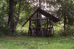 Summer house in the forest. Gazebo in the woods for recreation Royalty Free Stock Images
