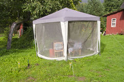 Summer house tent with mosquito protection in farm yard Stock Photography