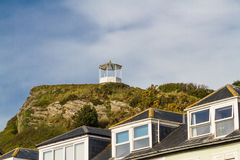 Summer house at top of rocky outcrop. Stock Images