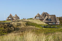 Summer houses at Hoernum, Sylt. Thatched roof summer houses in the dunes of Hoernum, Sylt stock photos