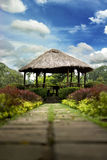 Summer hut in a garden. Rural hut in the middle of beautiful colorful garden Stock Image