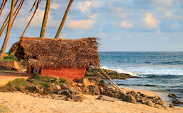 Summer hut on ocean shore. Summer hut with straw roof on ocean shore Royalty Free Stock Photo