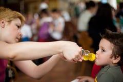 Boy drinking juice Stock Photos