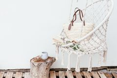 Summer hygge concept with hammock chair in the garden Stock Photos