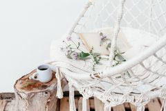 Summer hygge concept with hammock chair in the garden Royalty Free Stock Image