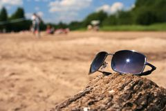 Summer I. Summer scene with sunglasses reflecting the sun royalty free stock photos