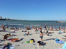 Beach with people royalty free stock photo