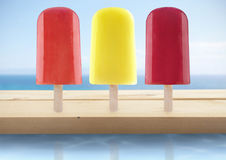 Summer ice lollies. Assorted ice lollies by the beach Royalty Free Stock Photos