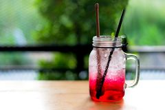 Summer iced fresh drink, red juice and cocktail with ice and mint. Stock Images