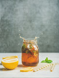 Summer Iced tea with lemon and herbs, copy space Stock Images